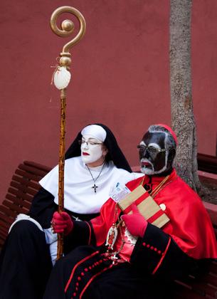 Black cardinal and white nun