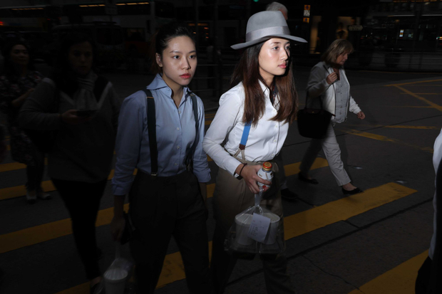 Two ladies are crossing the road with boyish style