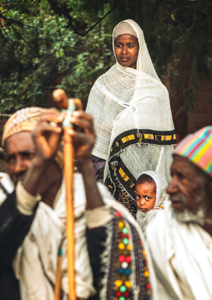 Mother and her daughter during the sunday mass in one of the rock-hewn churches in Lalibela, Ethiopia.