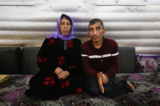 Um Ali and her son Ramadan, Syrian refugees in the Bekaa Valley, Lebanon, January 2017