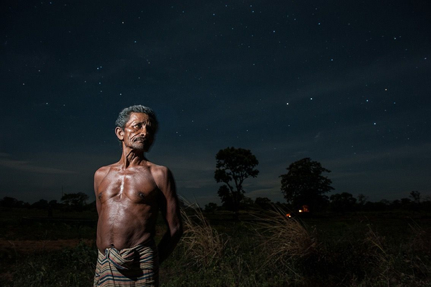 Palgedara Herata Banda is a farmer who works in an onion farm during the night in Sigirya, Sri Lanka.