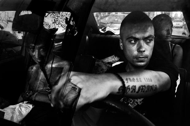 Kostas 24 his brother and sister sitting inside the car. Athens, Greece Enri Canaj