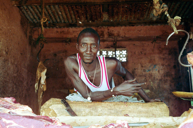 Although he lives in an outlying suburb, and enjoys a much more traditional life than his counterparts who live or work in central Dakar, this butcher's old school style looks like it might have been lifted directly from an early 1980s music video.