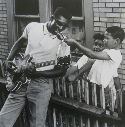 West Oakland, Man with Guitar and two children