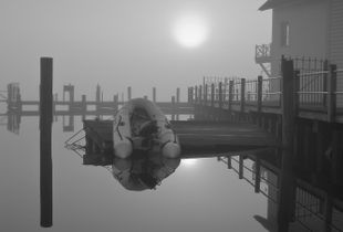 Inflatable Dinghy in Morning Fog - Still Waters