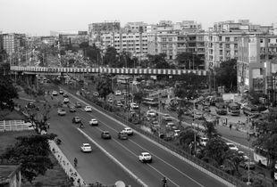 Striped Bridge over a busy Urban Area in Calcutta