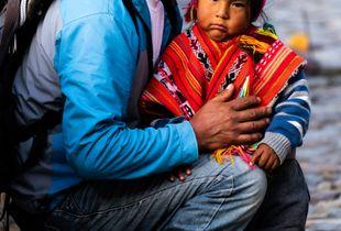 Quechua Girl and Man - Ollantaytambo, Peru, December 2018