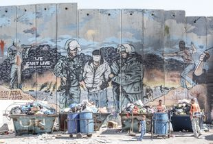 Garbage collection next to the Wall in the Aida refugee camp in Bethlehem
