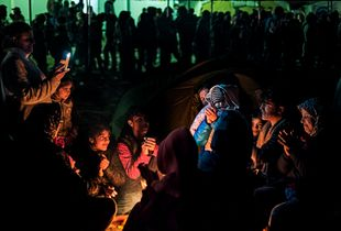 Resilience - singing around the fire in Idomeni refugee camp (March 2016)