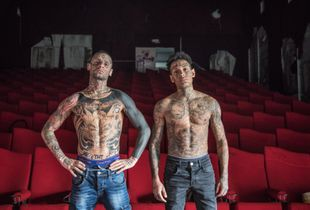 A portrait of Alessio and Diego in an empty movie theater