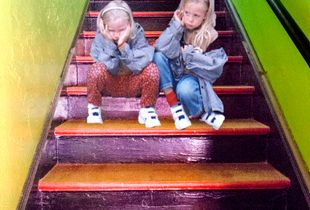 Bored girls on a stair case