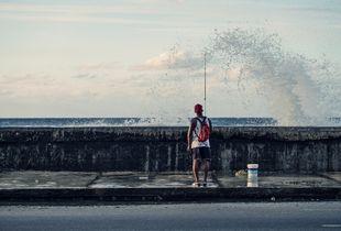 Streetlife of cuba series, fisherman on the malecón of havanna