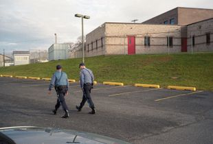 Two officers outside the jail