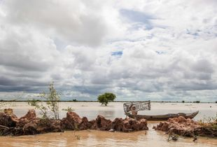 Fisherman in Cambodia during the monsoon