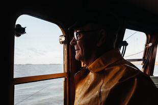 fisherman looking outside of window