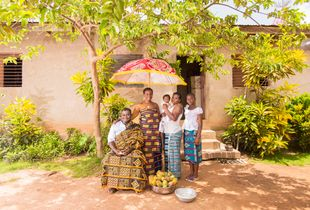 Jean & his family, in the courtyard of their house in Koitienkro Ivory Coast
