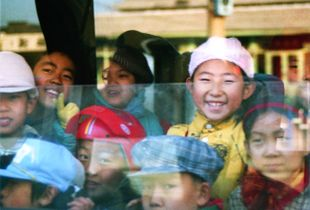 Kids on a bus in Beijing