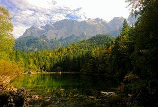 Reflecting upon towering mountains