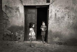 Two girls in a doorway, Mangal Bazar, Patan, Nepal