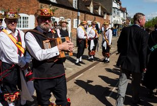 Morris dancers wait to join the Shakespeare Birthday Celebration Parade. They will join after King Edward VI School, who started celebrating the day decades ago.