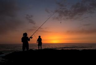 Spanish fishermen at sunset.