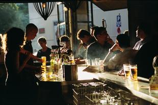Busy bar scene in Montparnasse, Paris