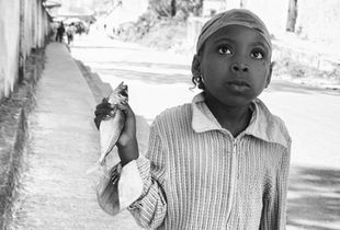 Portrait of little girl with a sardine.