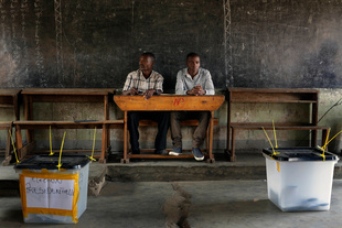 Election observers sit in an empty  polling station for the presidential elections in  Bujumbura, Burundi, Tuesday July 21, 2015. Photo by Jerome Delay