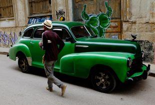 Vintage green sedan in Old Havana, Cuba