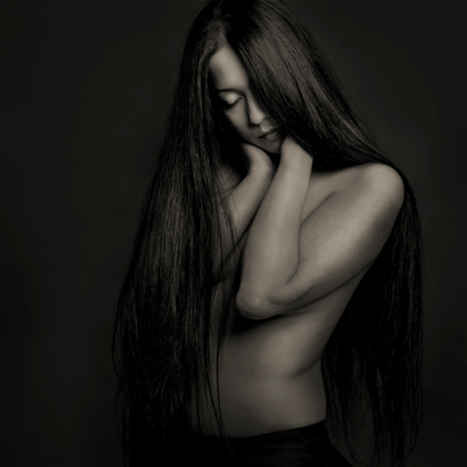 She keeps her hair long because she loves the way it feels, part cloak, part mane, part security blanket.