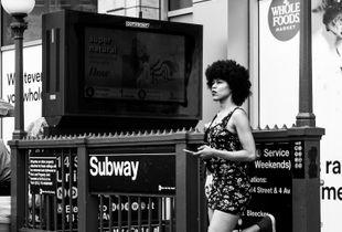 Woman at Subway Entrance