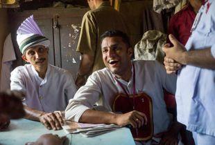 Waiters laugh and joke during a break in the staffroom of the Indian Coffee House, Kottayam, Kerala, India ©Stuart Freedman