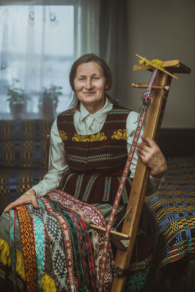 Traditional crafts. Portrait of the Band Weaver
