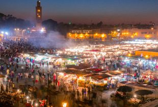 Twilight in Djemaa el-Fna square, (the main square) in the old medina in Marrakesch, Morocco