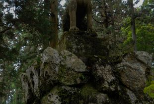 Guardian wolf statue at the Jomine Shrine