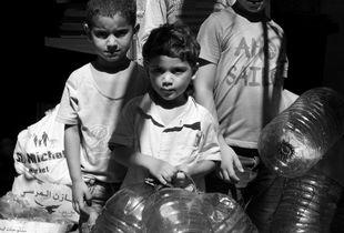 Palestinian refugee children on their way to buy water. Mar Elias Camp, Beirut, Lebanon. 2018.