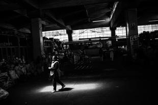 Vendor Walking into Sunlight