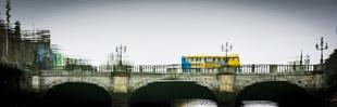 Dublin bus on bridge over the river