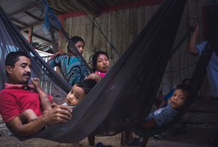 Pedernales, Ecuador. Families get comfortable in hammocks and wait while other family members are seen by the local NGO clinic's doctors. Basic first-aid supplies such as bandaids, anti-inflammatory medication, among other items are also distributed here at these monthly check-ups.