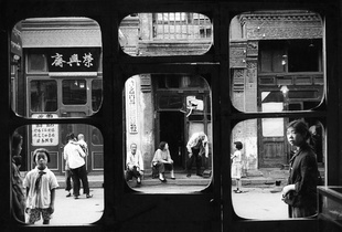 These windows overlook Liulichang, the street of antique and curio shops. Here, during the Cultural Revolution, people were expected to hand over their jewelry to the state, receiving nothing in exchange. China, 1965