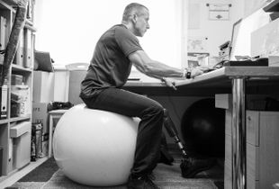 sit on swiss ball