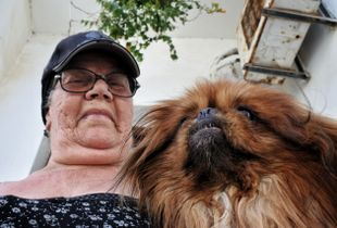 A local lady and her dog, Paros island, Greece