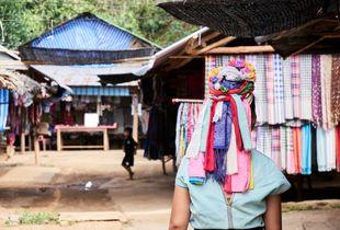 Karen woman walking in the village