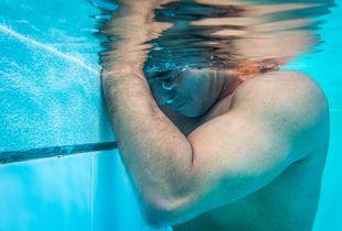 Moises Fuentes Garcia, 41, takes a break during a training session at the Simon Bolivar Aquatic Complex, Bogotá, June 2016.