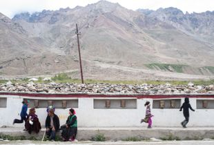 As the adults wait to catch a glimpse of His Holiness, the children run around besides the prayer wheels on the main street of Padum in Zanskar Valley in Ladakh that is, on an average - 4000 meters above sea level.