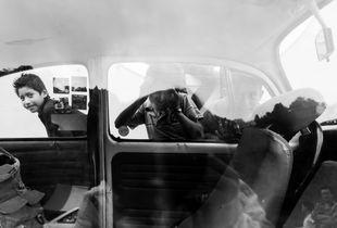 Kids looking through VW window