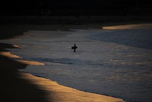 Bodyboarder at sunset.