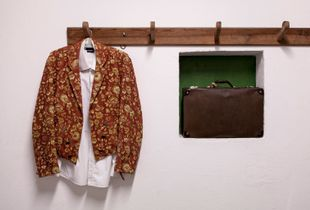 The 'jaqueta' or  forcado's jacket  in the dressing room before the bullfight. The jacket distinguishes each group from a another because of the different fabrics and patterns. It is also extremely important for the forcados since it passes from generation to generation. © Eduardo Leal