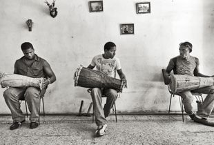 Practicing La Clave, the Traditional African Beat on the Bata Drum