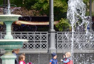 Kids playing around fountain